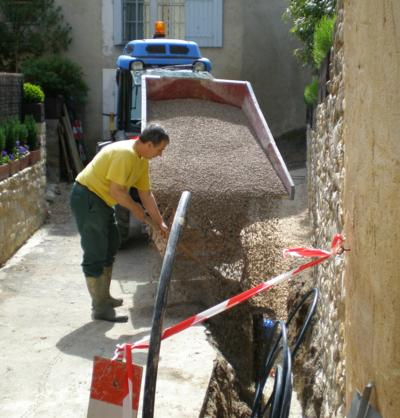 adduction d'eau potable dans ruelle village